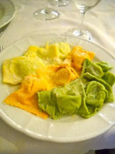 My piatto, an assortment of ravioli. The orange type is stuffed with pumpkin—delicious!