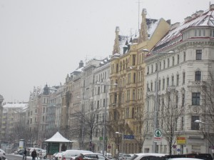 A row of picturesque buildings in snowy Vienna.