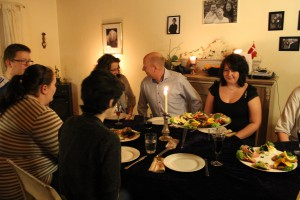 A dinner with famliy and friends with lots of candles, conversation, laughter and good food!