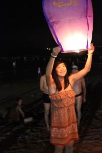 Lighting off lanterns at the beach