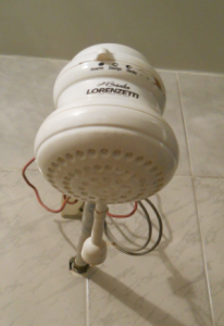 btdubs, it's not a good idea to touch the electric showerhead while showering