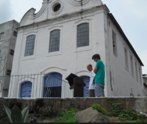 Edson, our tour guide, giving Alex a low-down on this 18th century church