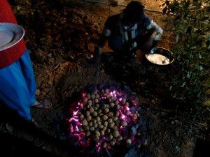 Bread being cooked directly in the ash of cow dung...Yum_