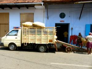 Men unloading a truck full of chilis in Kochi
