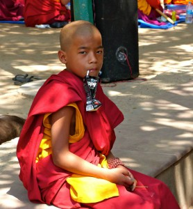 One of the young monks after chasing after the leaves. (photo credit: Lydia Greve)