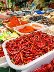 A collection of spices, peppers, and chili powders that are liberally thrown on every Sichuan dish