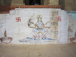 """""""Ganga Ma"""", or the goddess of the Ganges river, painted at a ghat"""