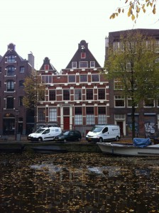 Leaf-filled fall canal and Amsterdam homes.