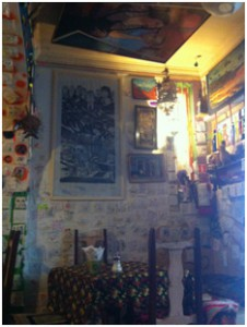 Café Color: a place where paintings are hung upside-down and everyone leaves napkin notes on the walls