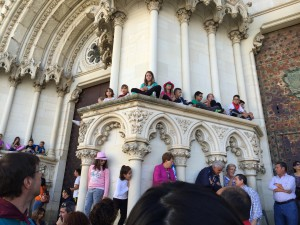 Children perched on the church and out of harm's way.